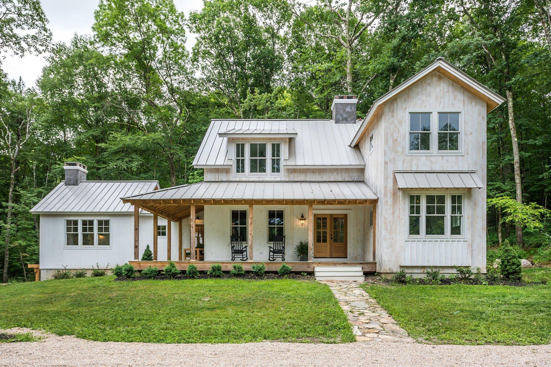 Beautiful custom farmhouse with whitewashed siding and real wood.