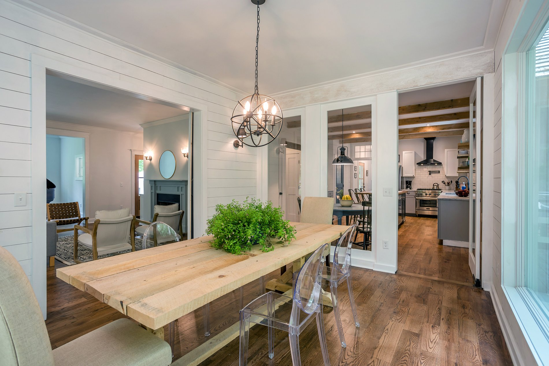 Country dining room with whitewashed wood beams.