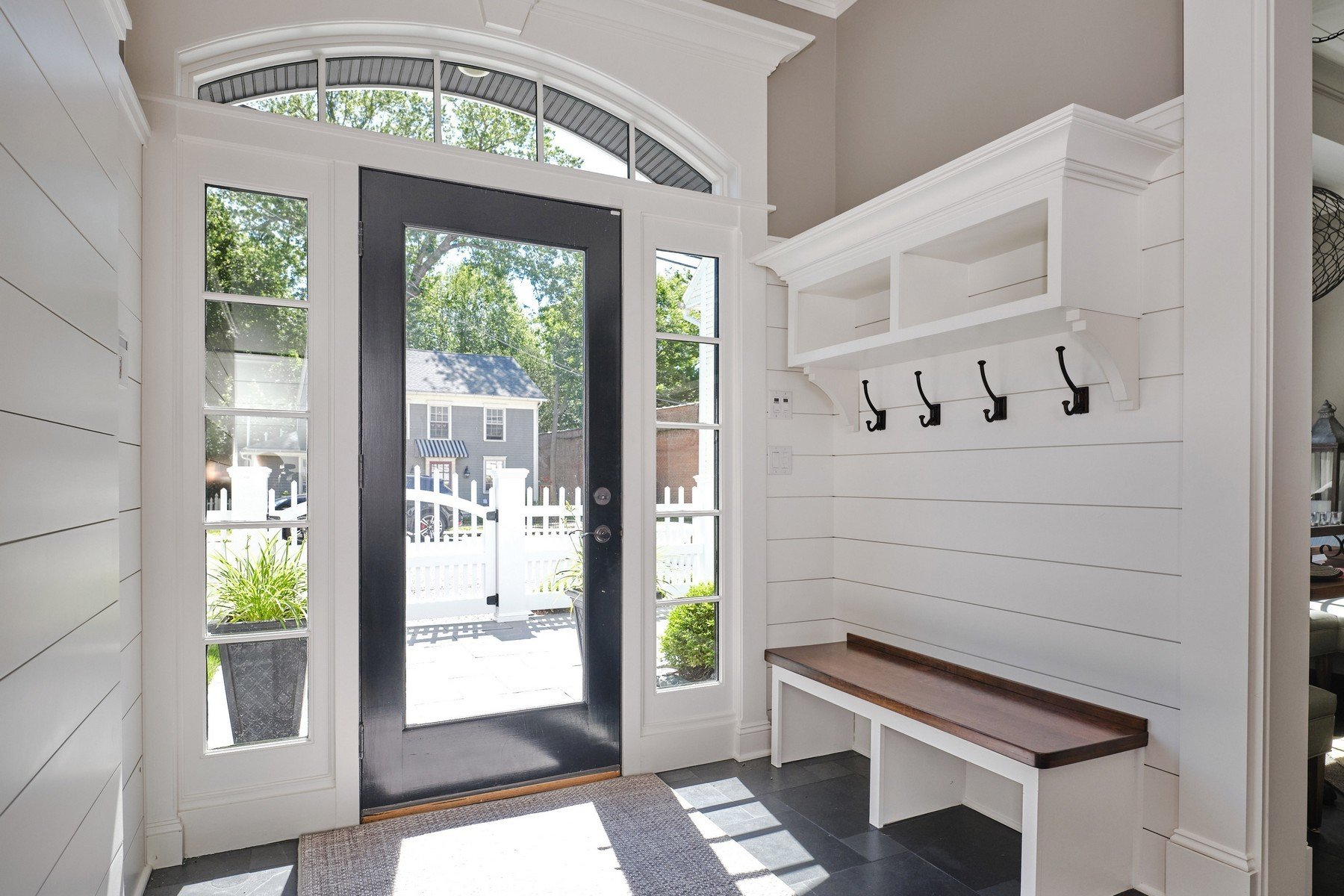 Mudroom foyer with shiplap painted white using Mountain peak by Benjamin Moore.