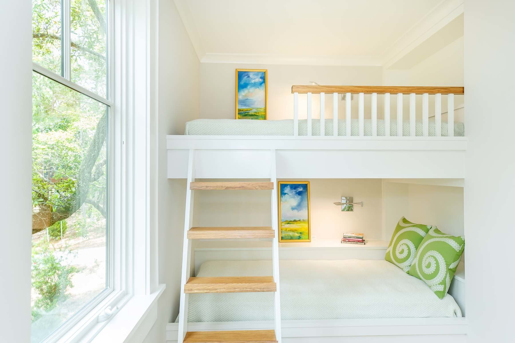 Farmhouse children's bedroom with permanent bunk beds painted pure bright white Chantilly Lace by Benjamin Moore.