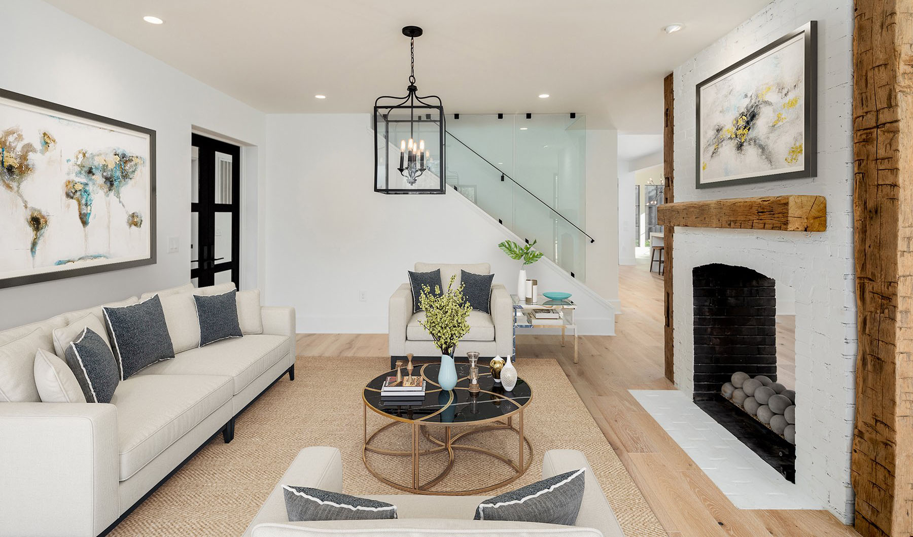 Farmhouse living room with Pure White paint, exposed wood beams and a white brick fireplace.