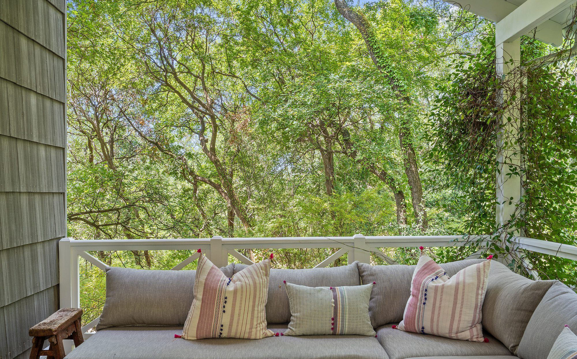 Colorful pattern indoor pillows used on the back deck outdoor sofa.