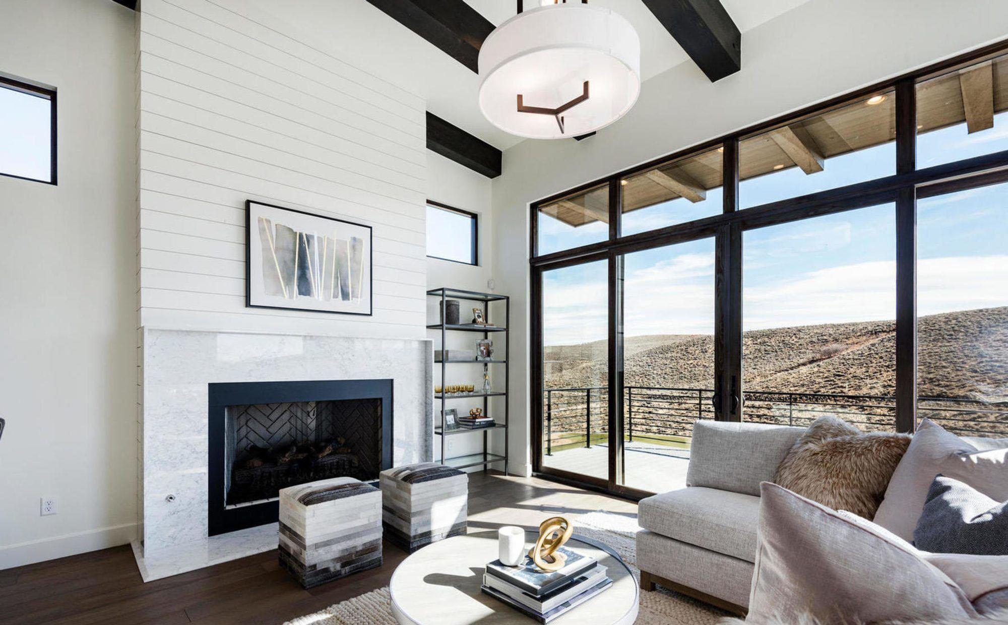 Modern home with thick sisal woven rug and a light grey sofa.
