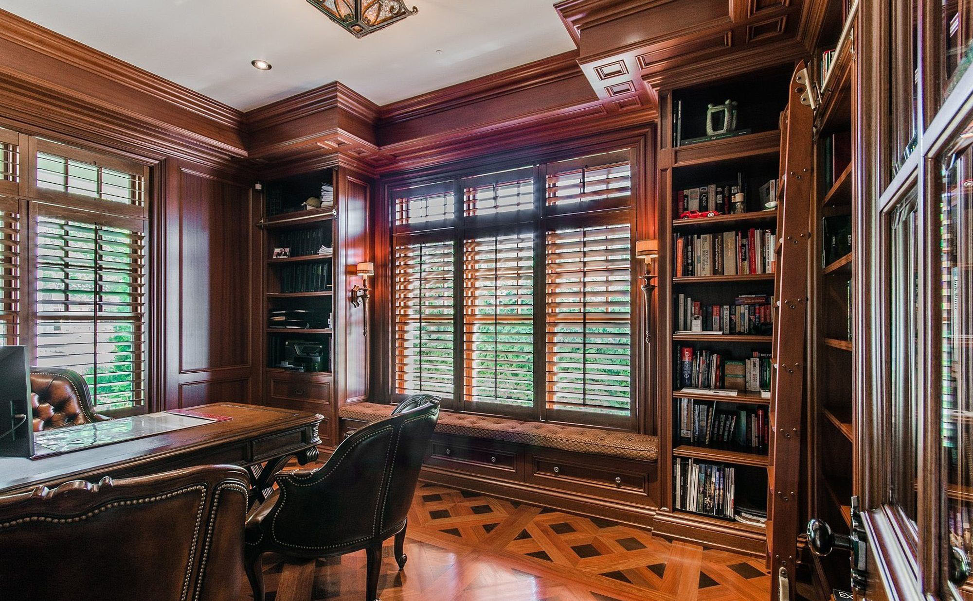 All wood home office with a window seat.