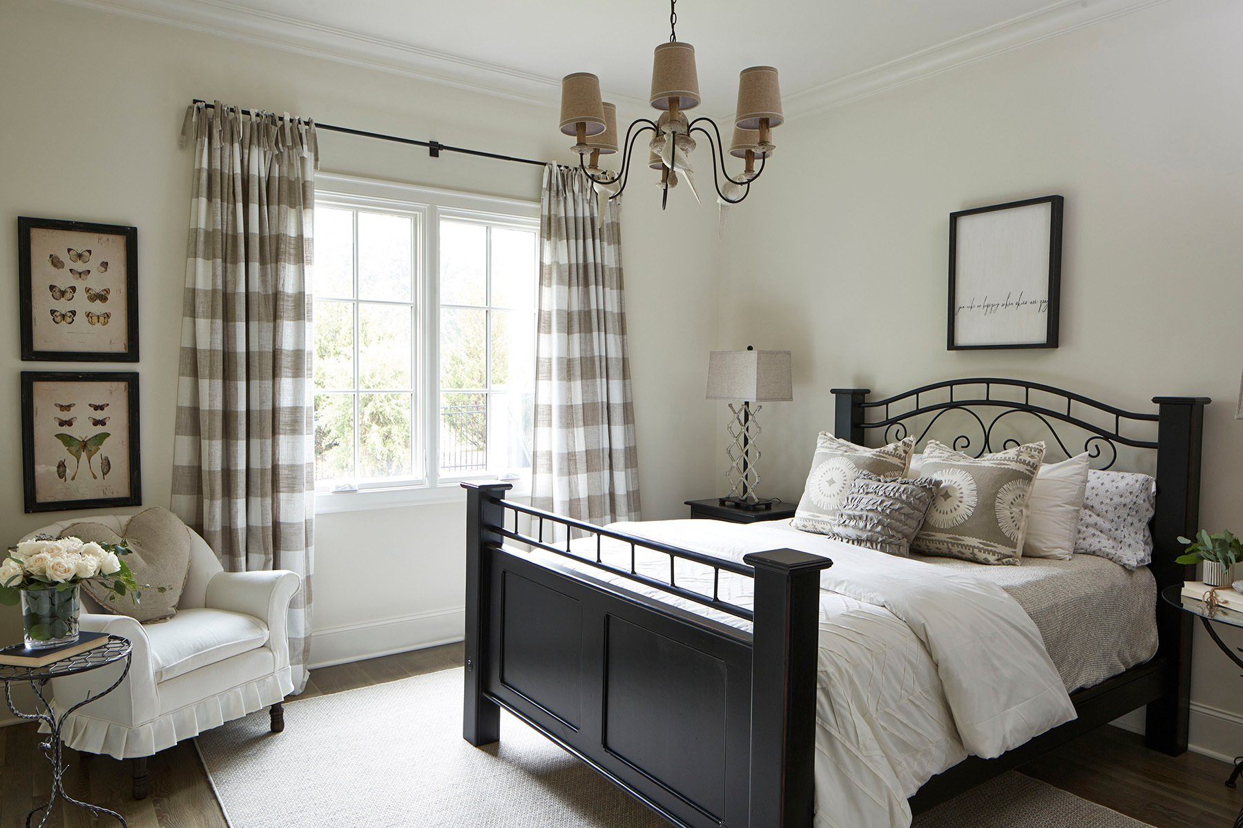 Beautiful farmhouse style small bedroom with a traditional design. black wooden bed frame. small bedroom design ideas