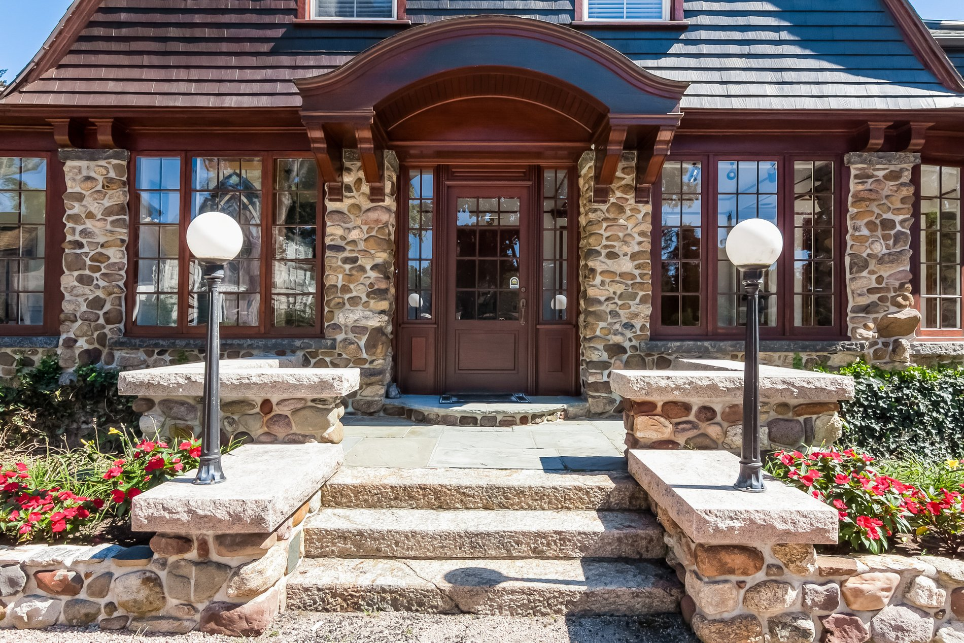 Country style arched wood portico built without columns. reasons to build a portico.