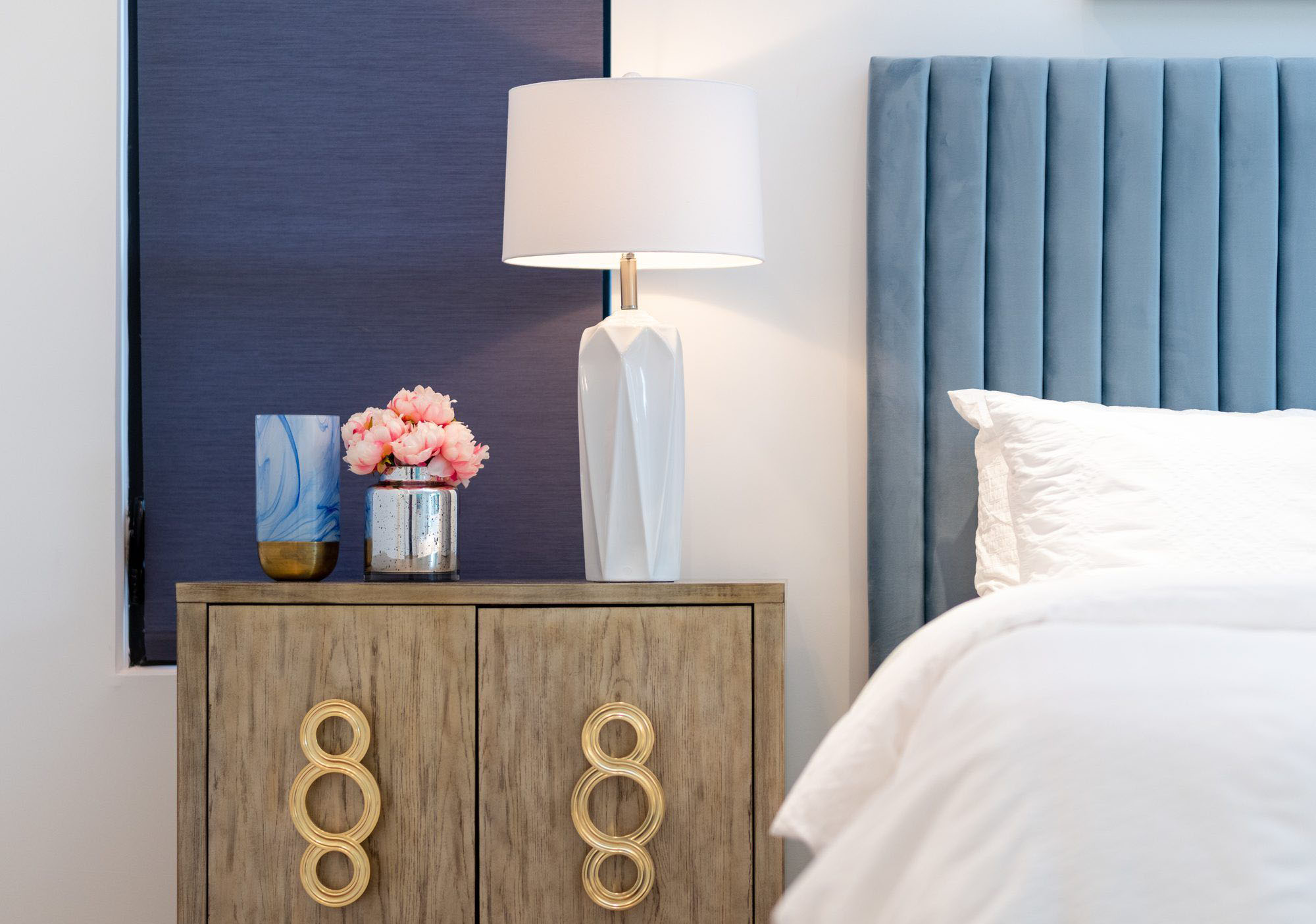 A bedside table with storage can add a lot of style and functionality to a small bedroom.