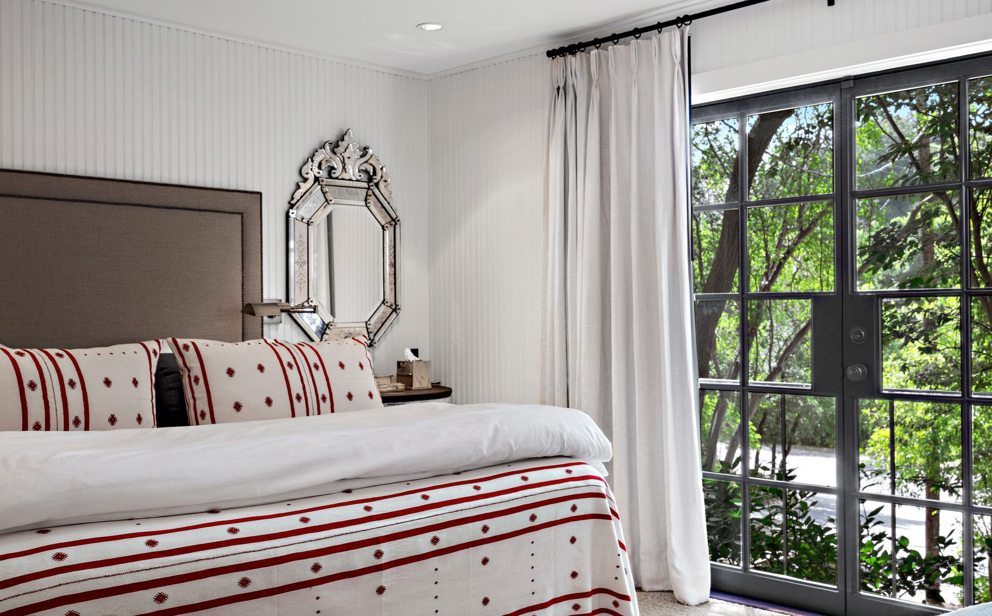Vertical wall paneling is a great way to make a small bedroom feel larger.