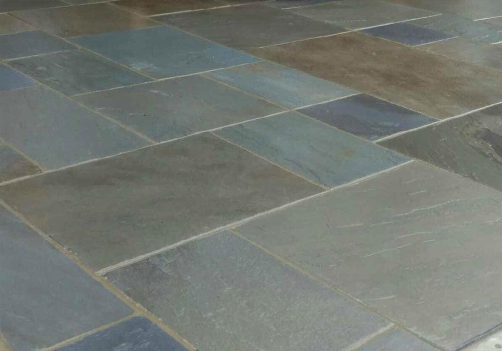 what is bluestone? closeup of off color bluestone patio tiles
