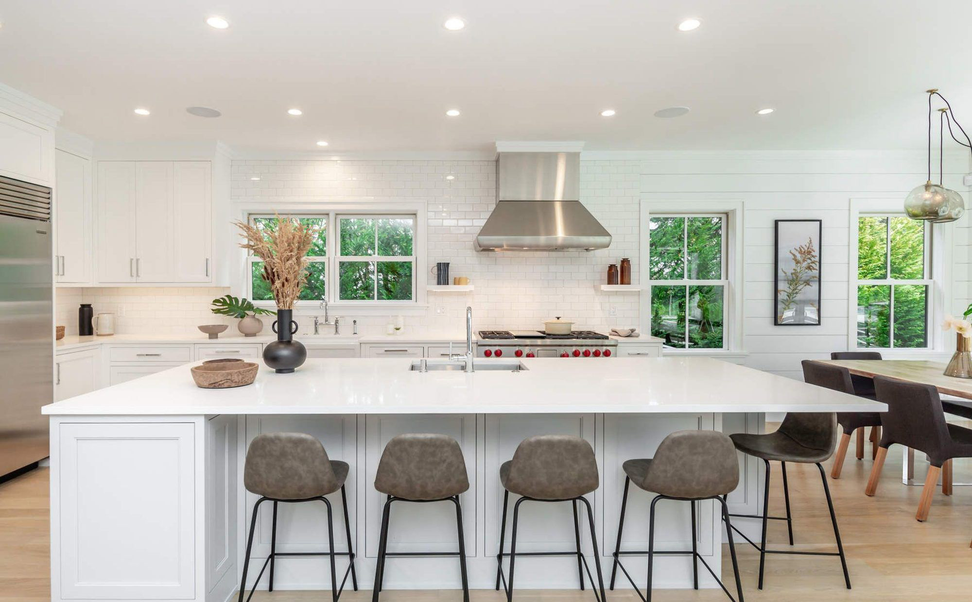 Large kitchen with an open floor plan featuring a center island and lots of seating.