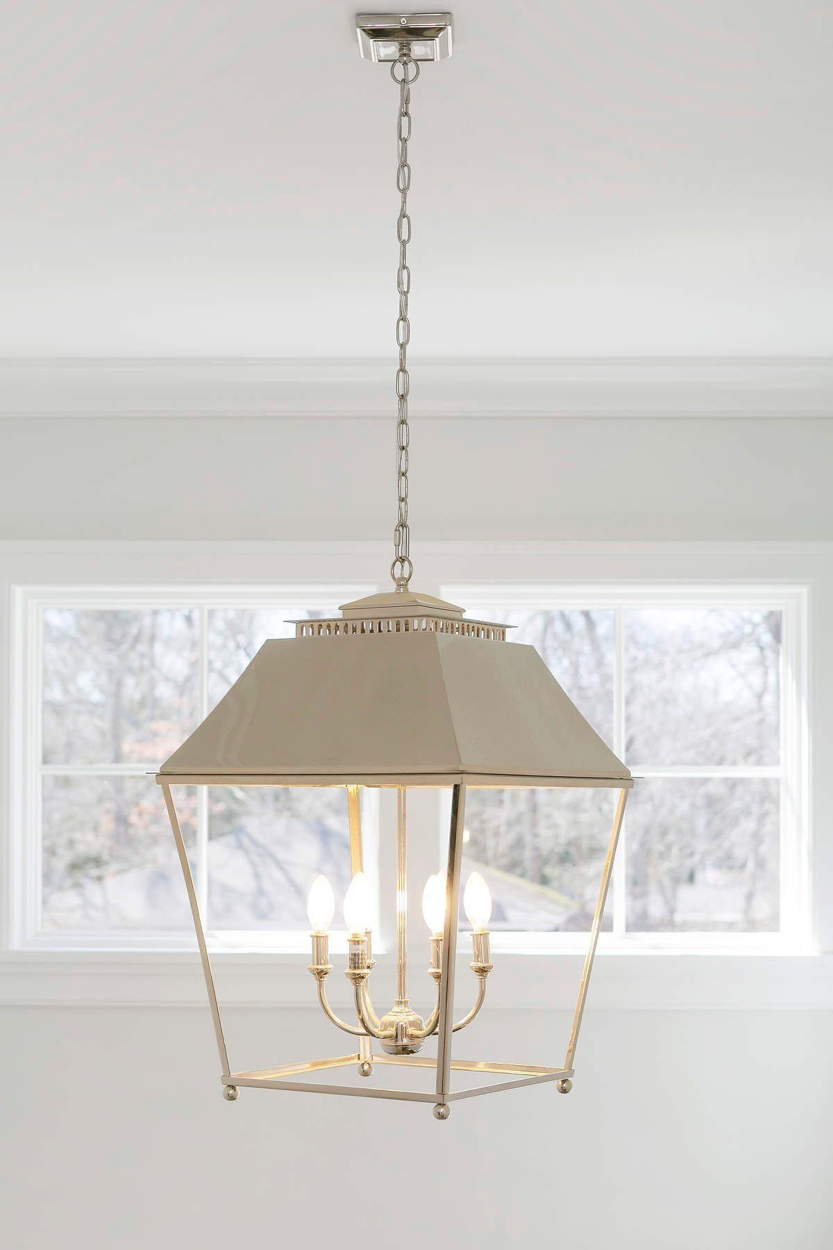 Laundry room with beautiful pendant light featuring a gold finish.