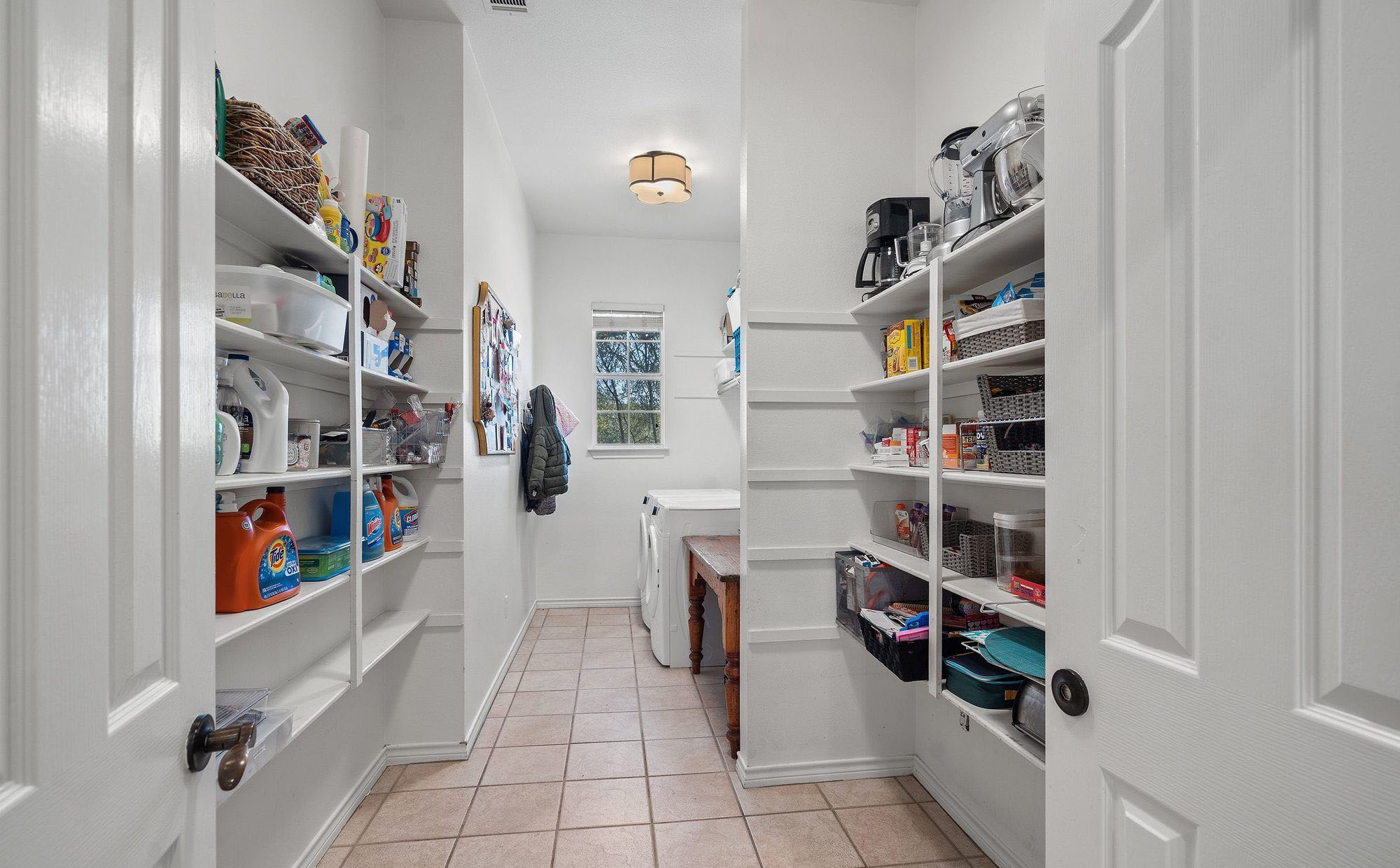 Laundry room with lots of open shelving.