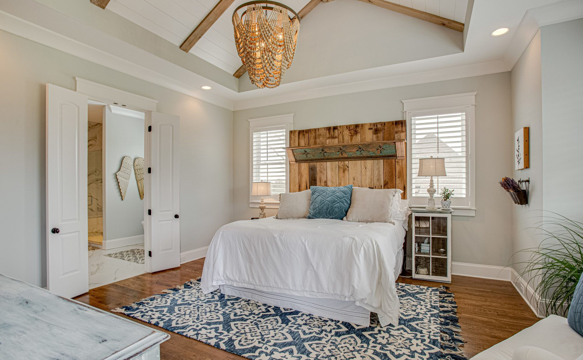 Bedroom vaulted ceilings with exposed timber beams and shiplap.