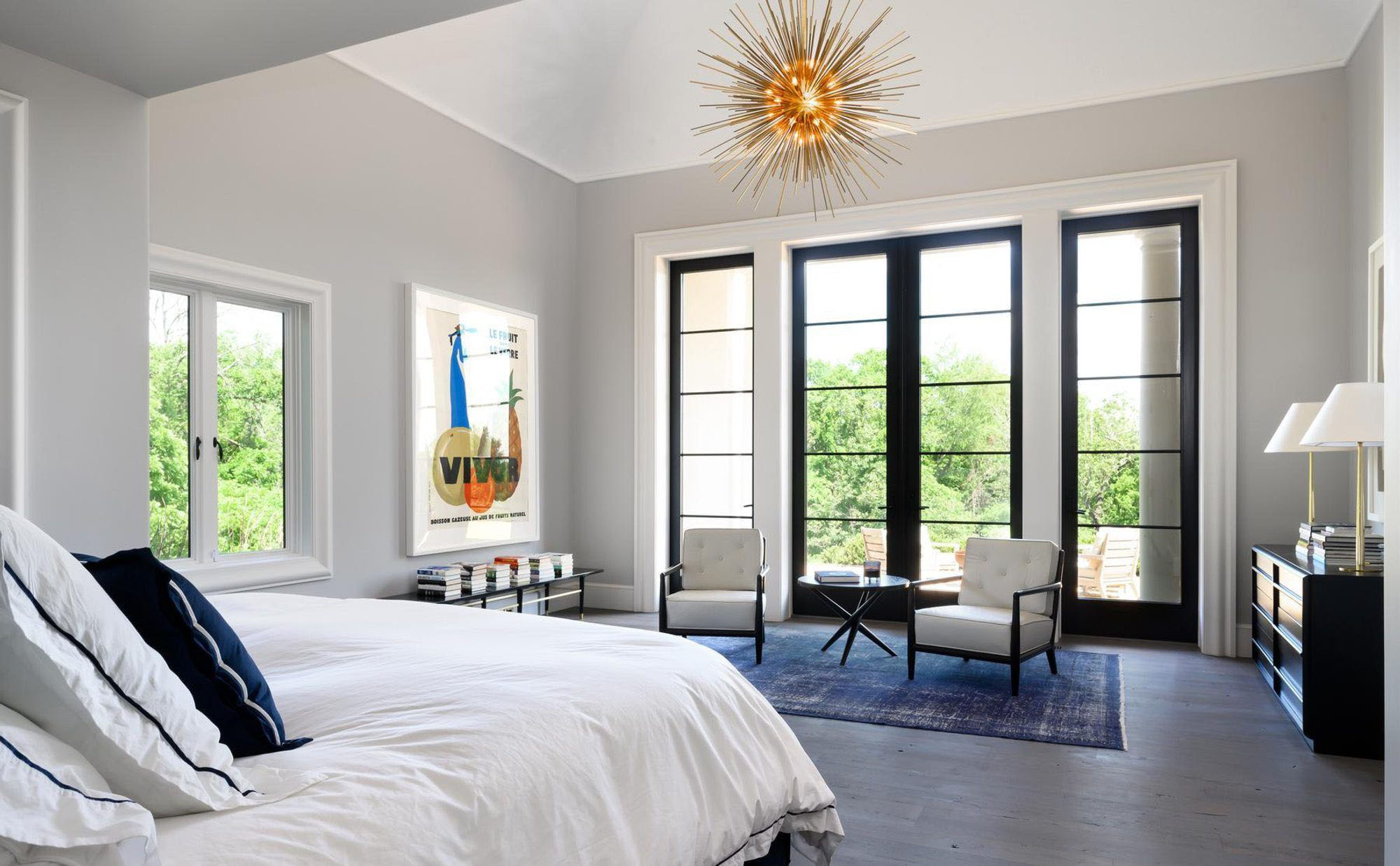 Modern style master bedroom with vaulted ceilings. white walls with black frame windows. vaulted ceilings pros and cons.
