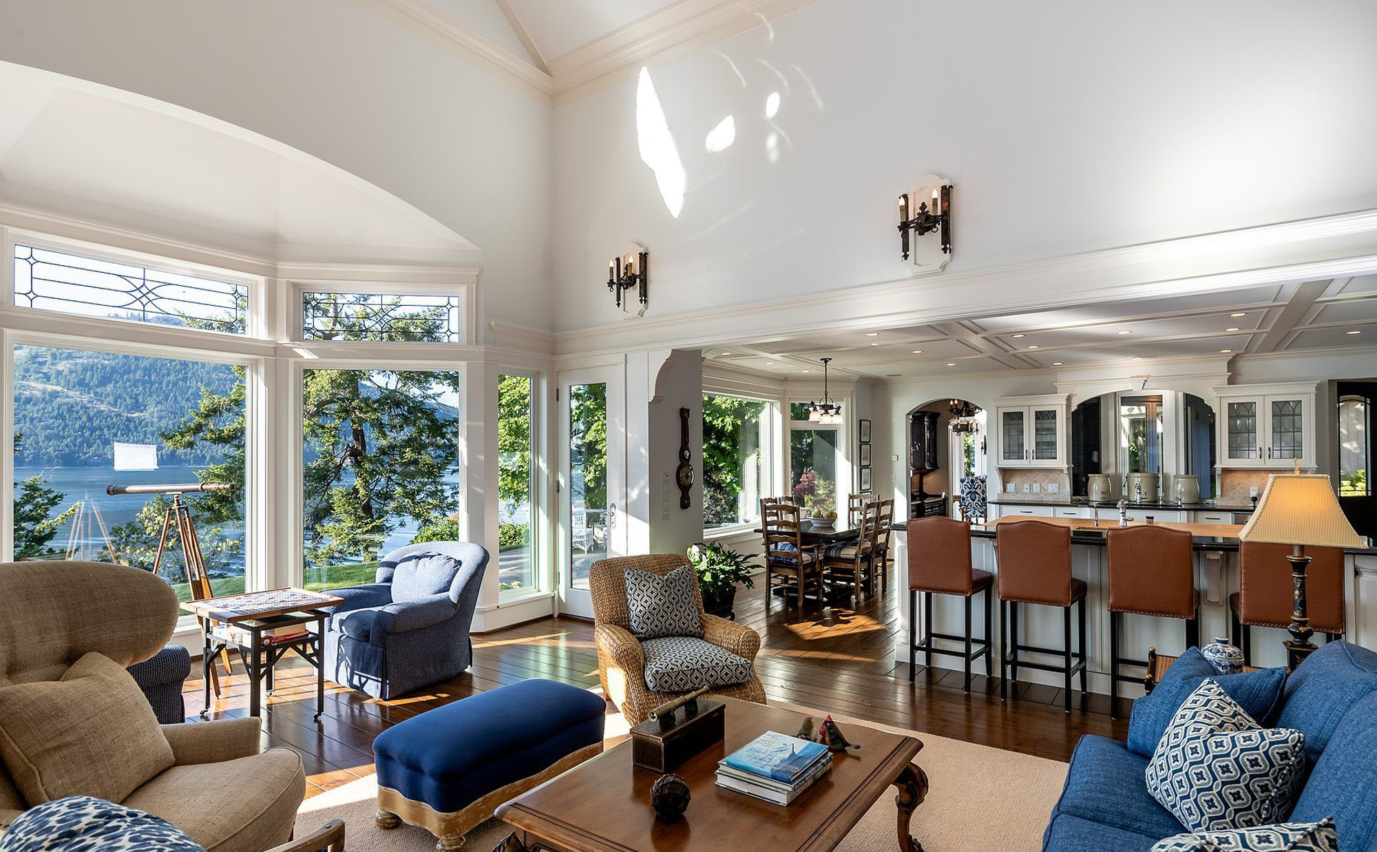 This beautiful lake house features vaulted ceiling finished with trim.