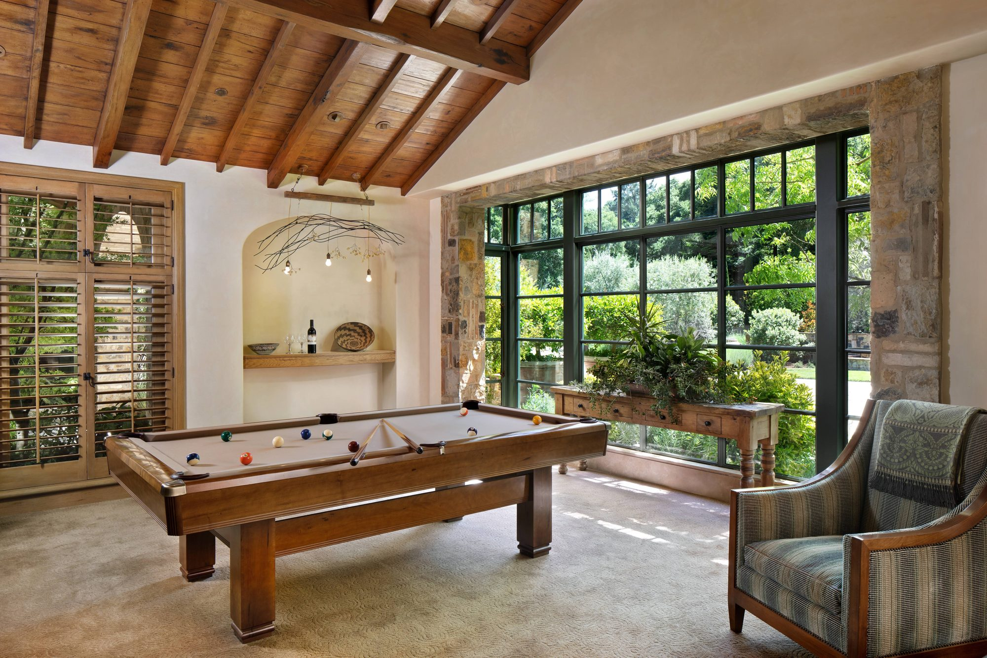beautiful game room with rustic style. Pool table, vaulted ceilings, all wood ceiling finish.