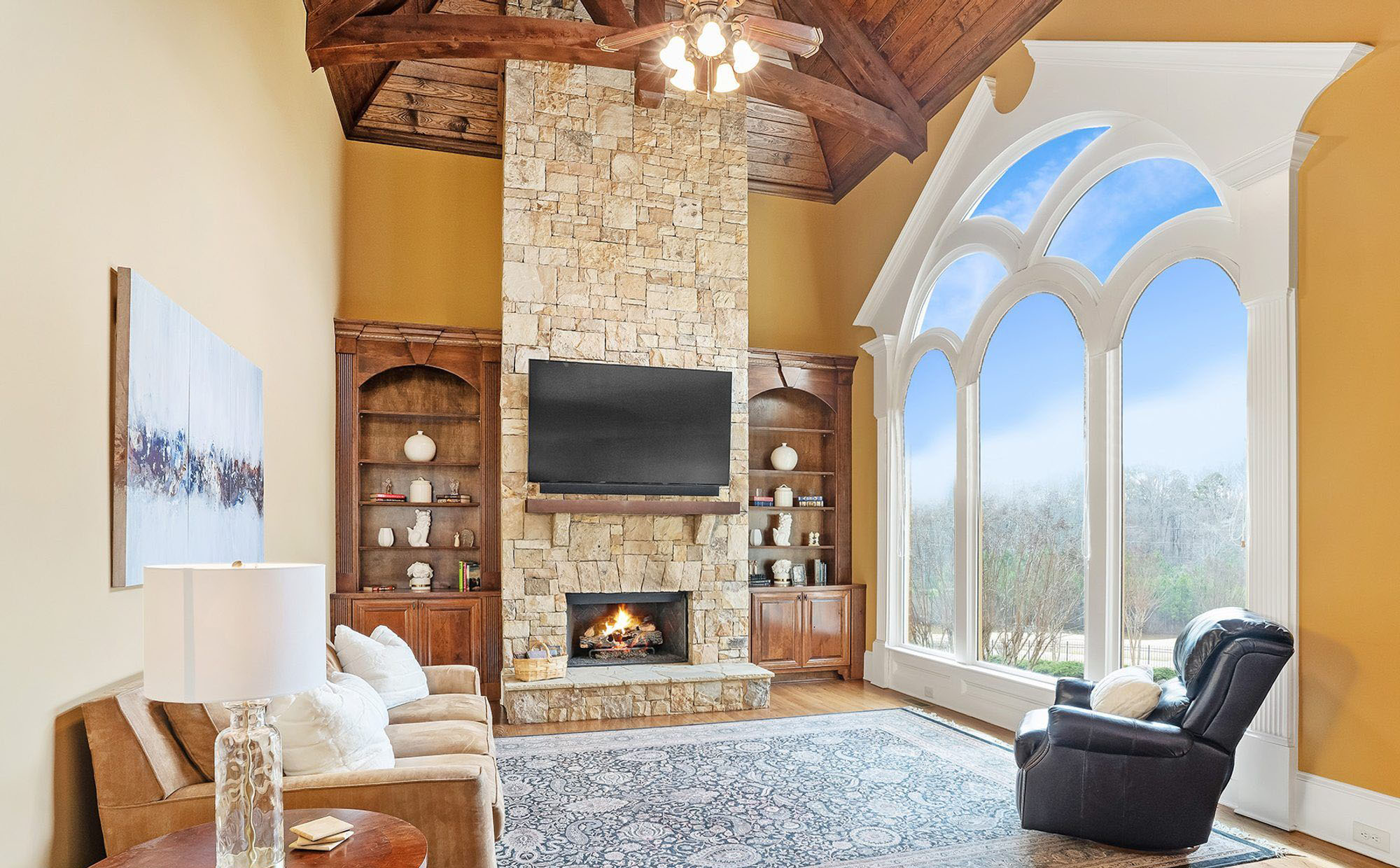 Vaulted wood ceiling with a rustic design. Exposed wood beams and ceiling.