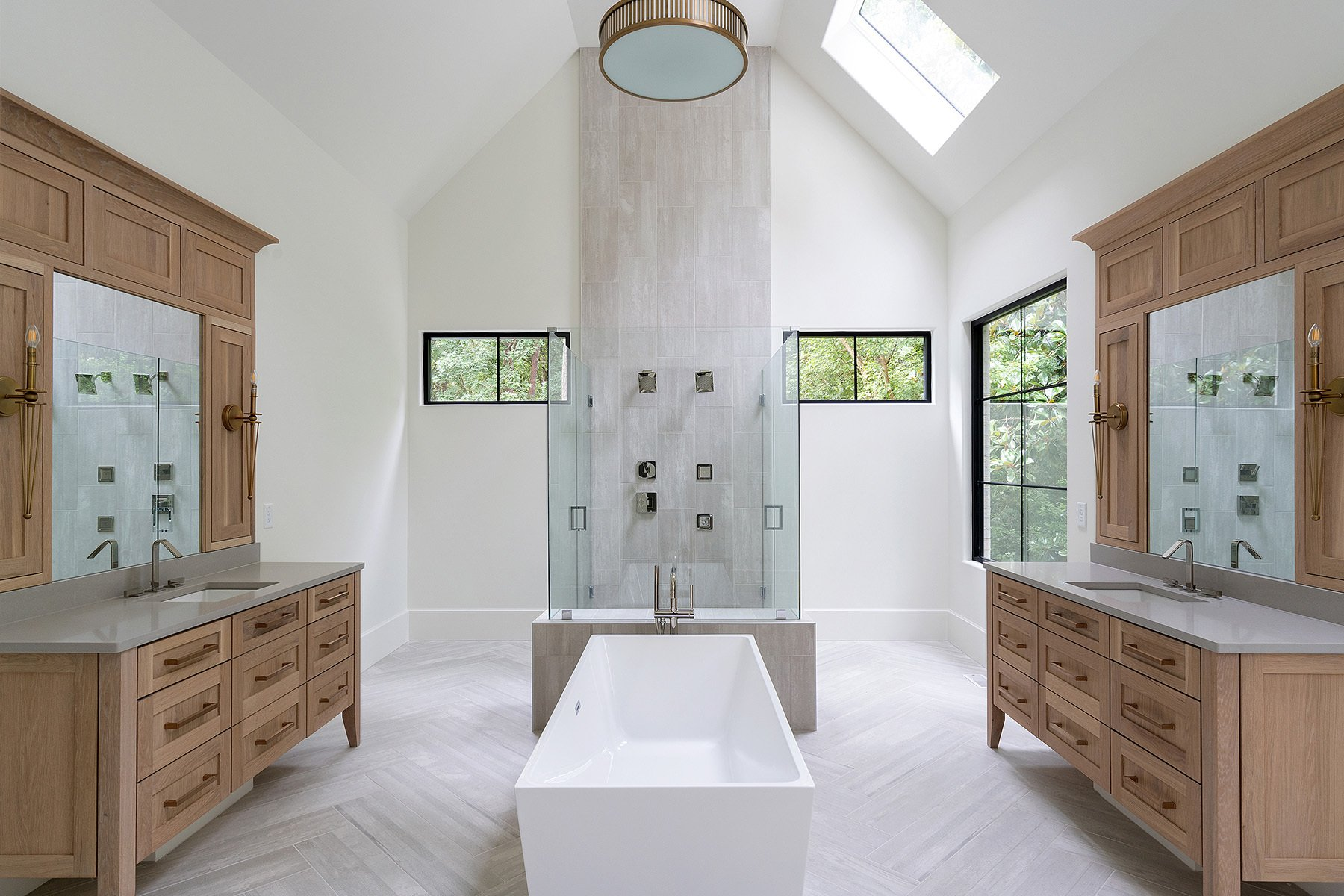 Bathroom vaulted ceiling with skylights. Modern design.