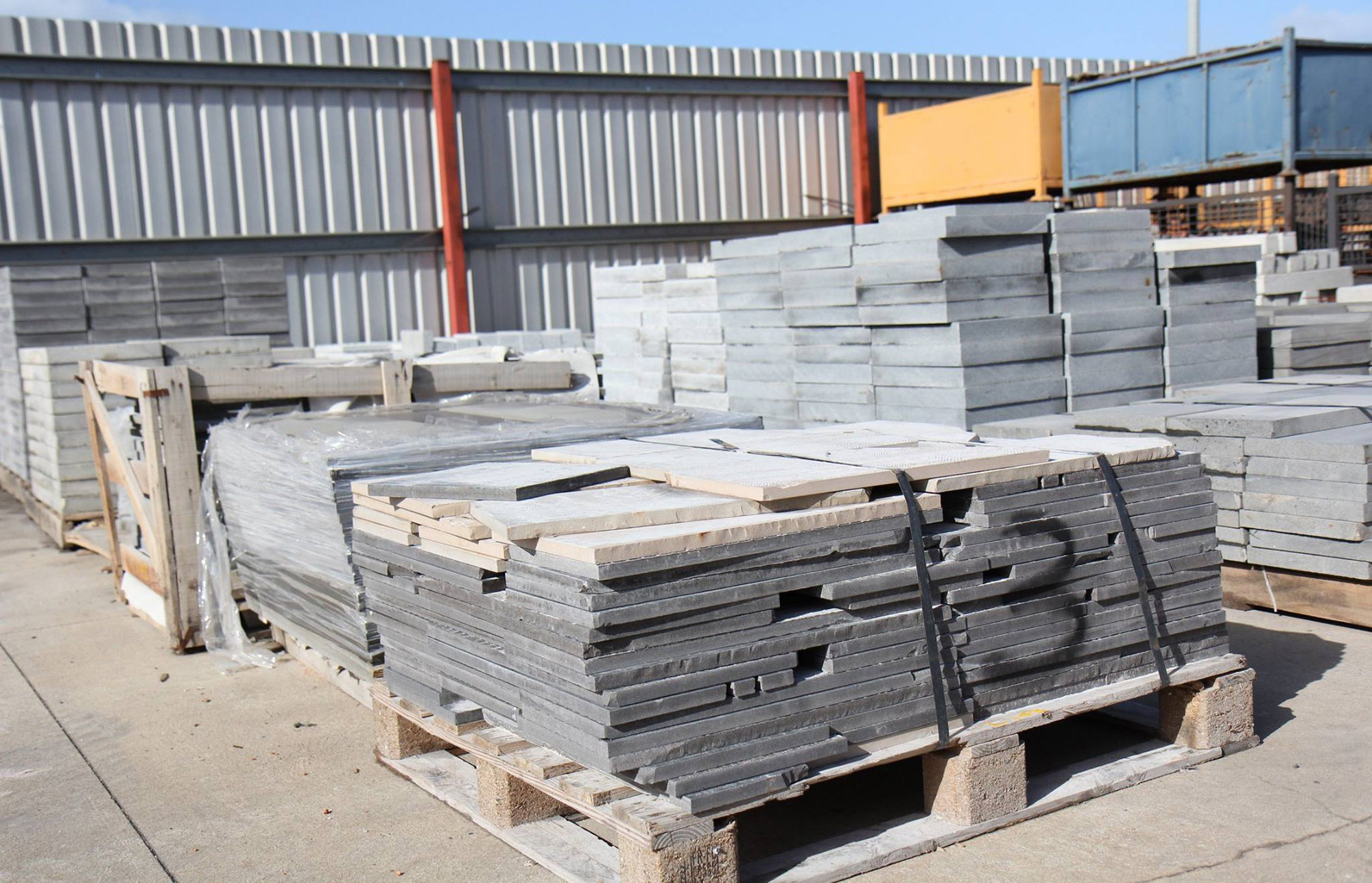 Palettes of bluestone at the dealer cut into a variety of shapes and sizes.