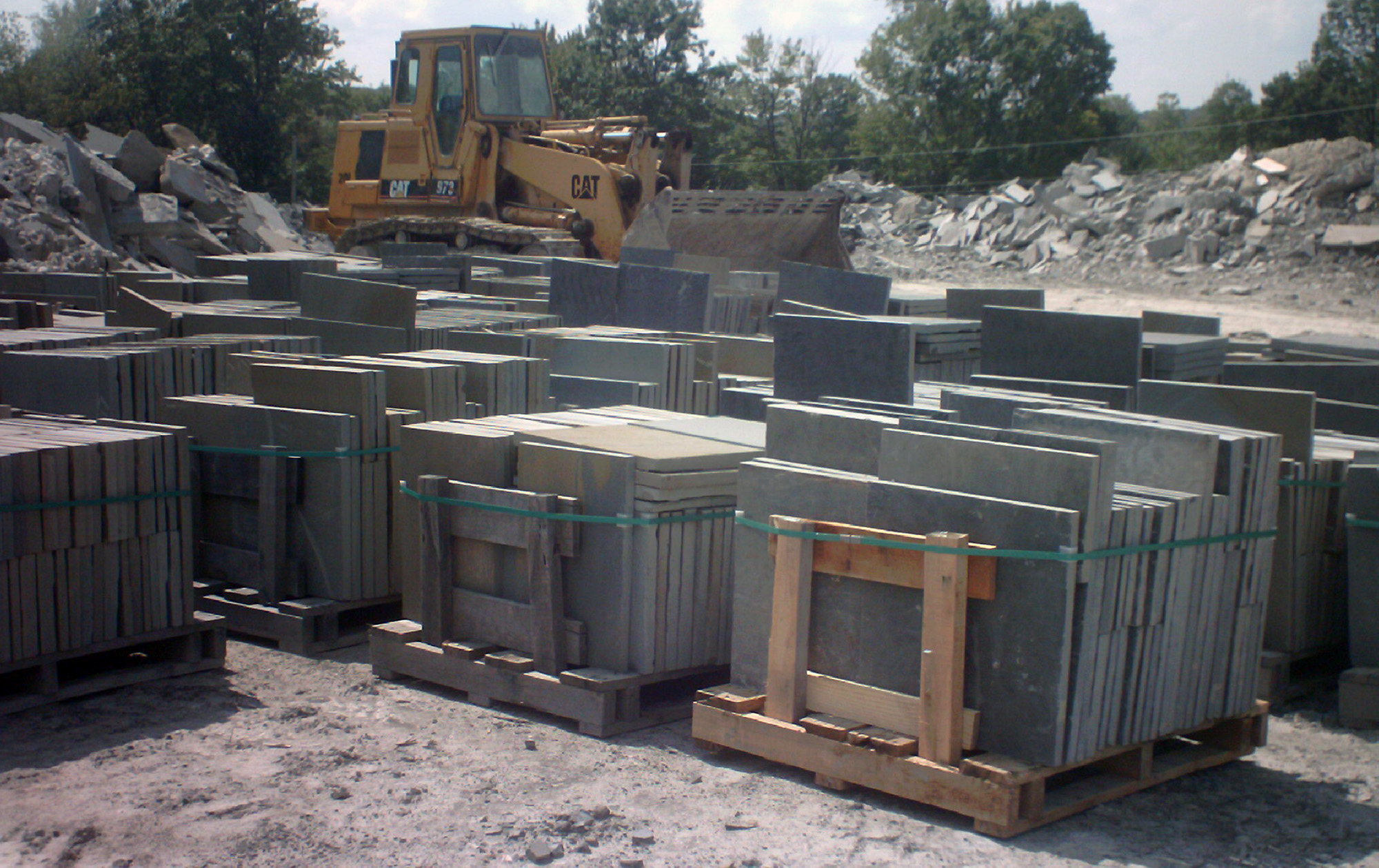 Stone dealer with palettes of bluestone cut into a variety of rectangular shapes and sizes.
