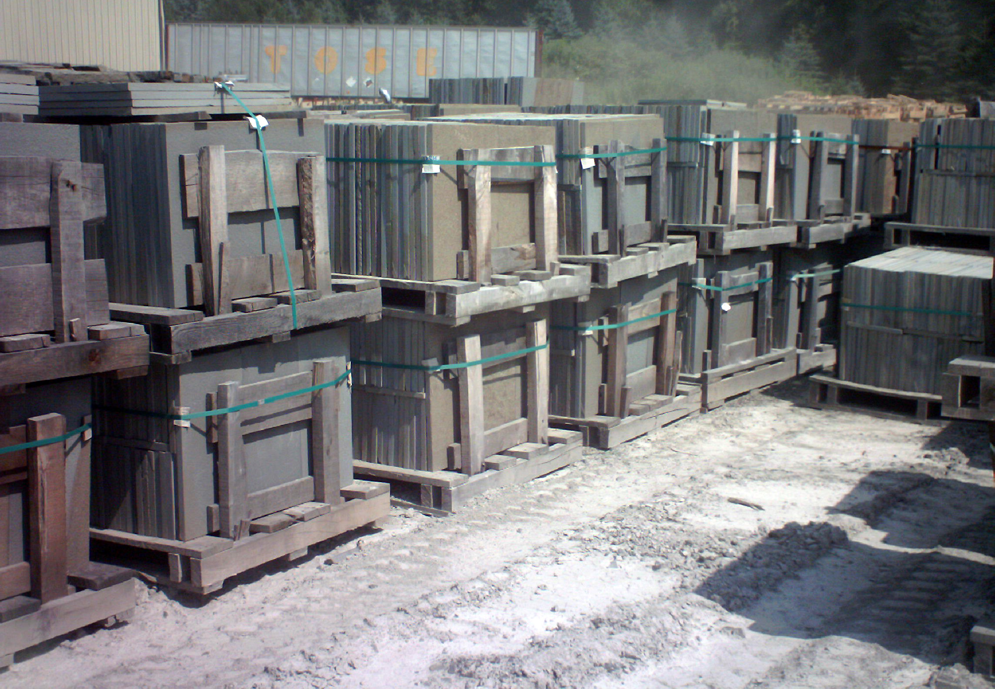 Palettes of stone cut into a variety of rectangular and square shapes and sizes.