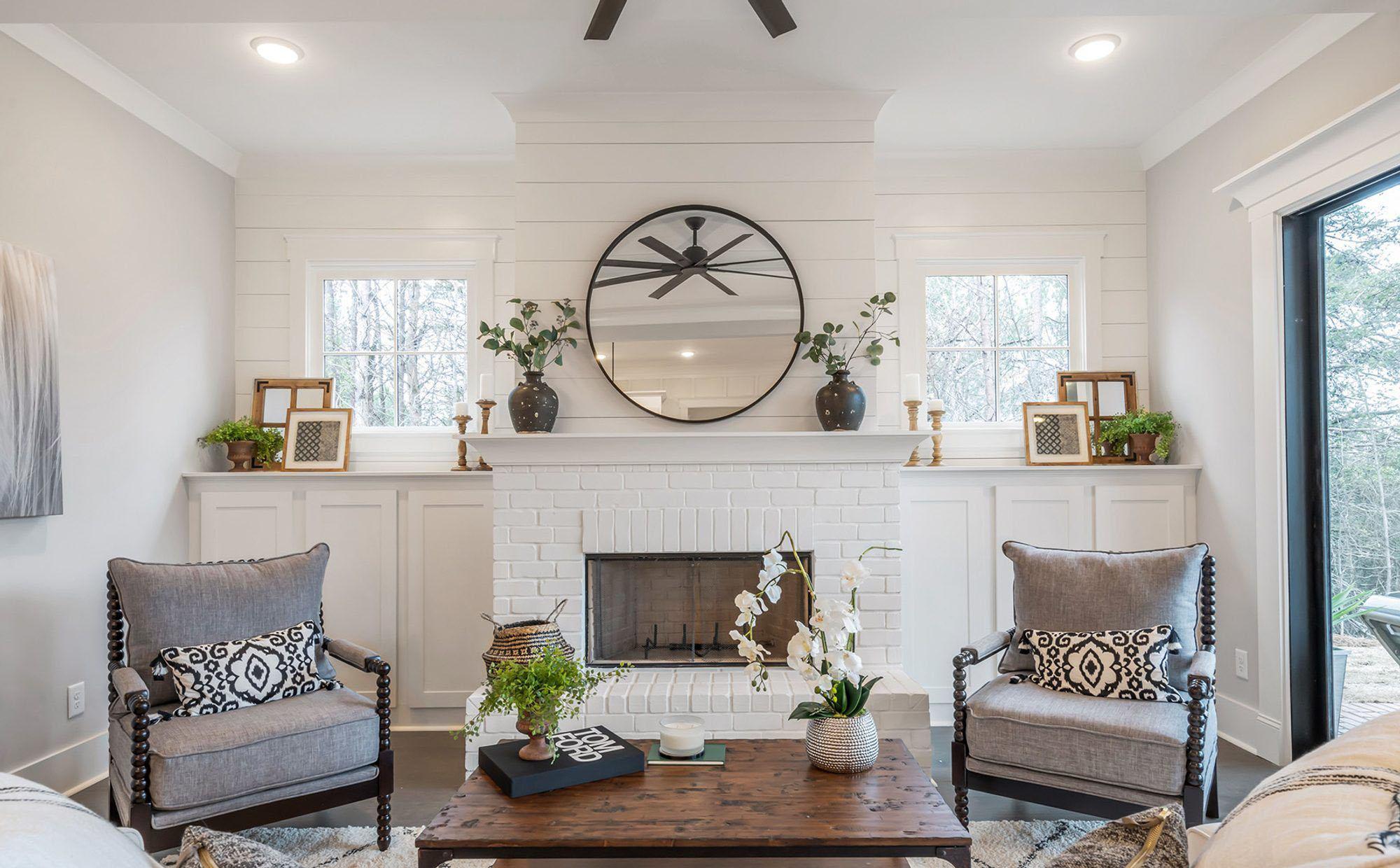 beautiful modern farmhouse fireplace surround painted white with shiplap.