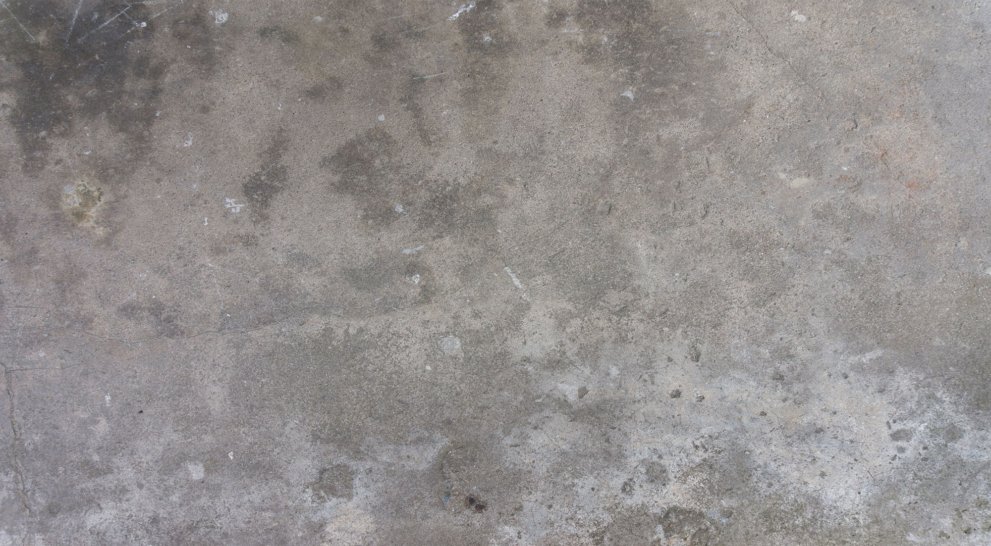 Concrete with discoloration including black spots.
