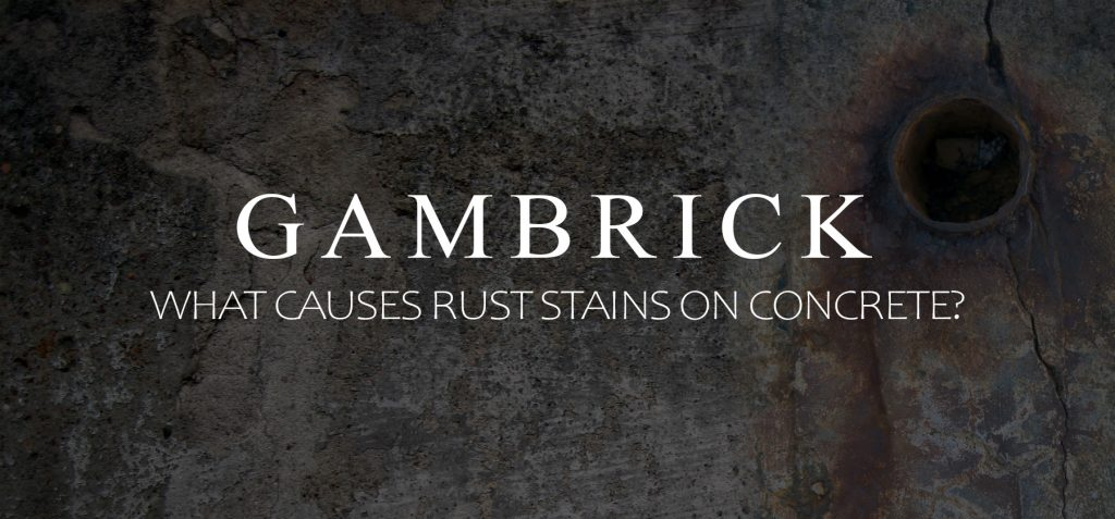 what causes rust stains on concrete banner