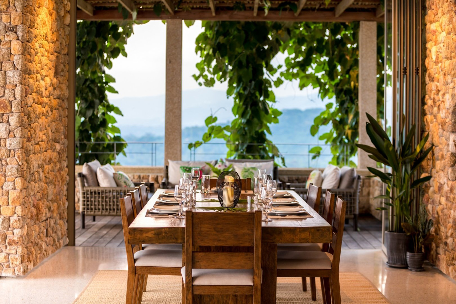 acacia wood patio furniture table and chairs under a pergola