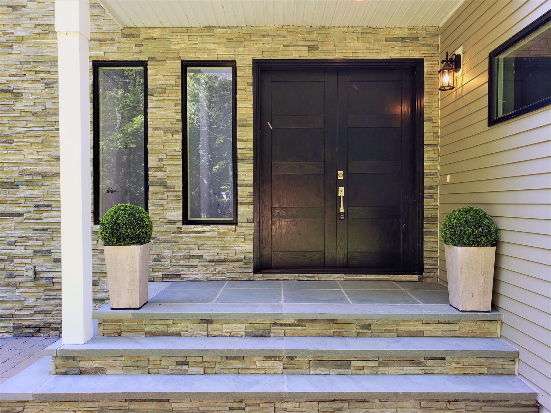 Modern black windows with cultured stone veneer.