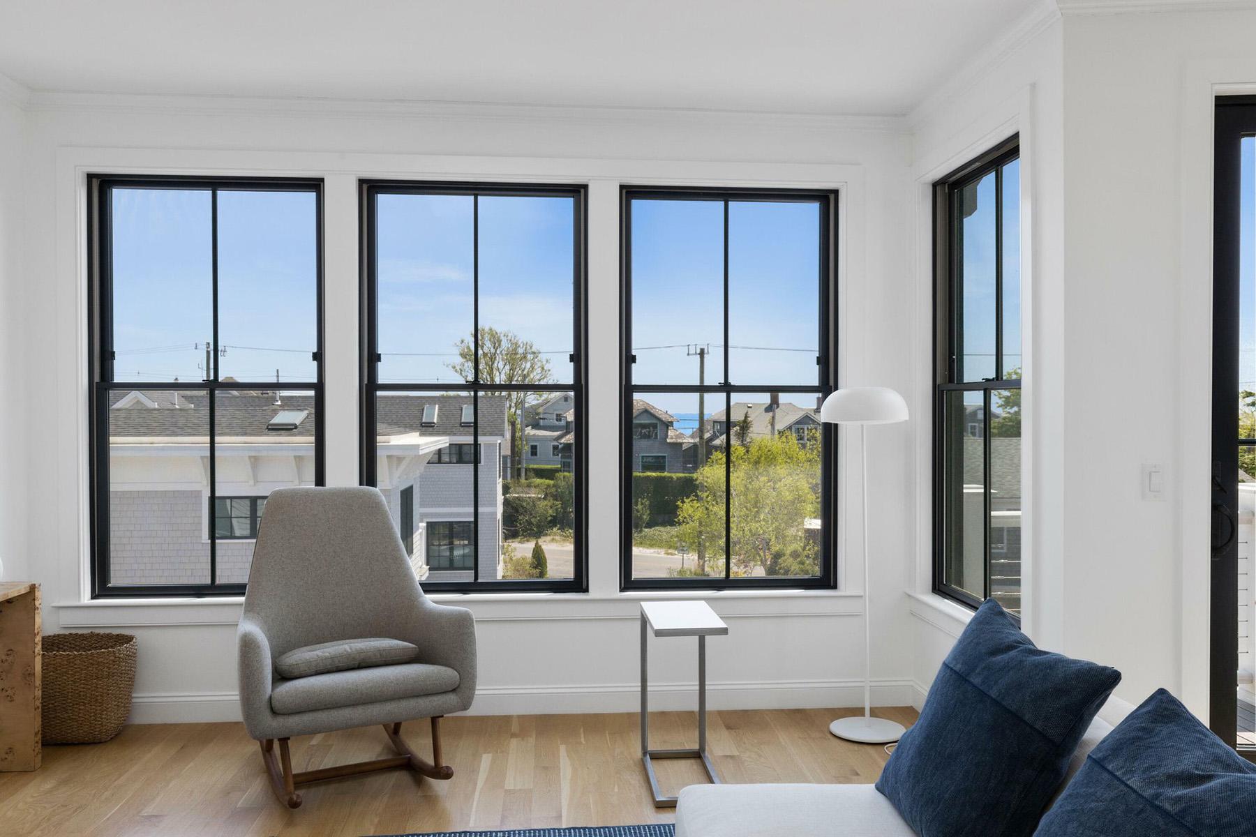 Sitting area with large black windows.