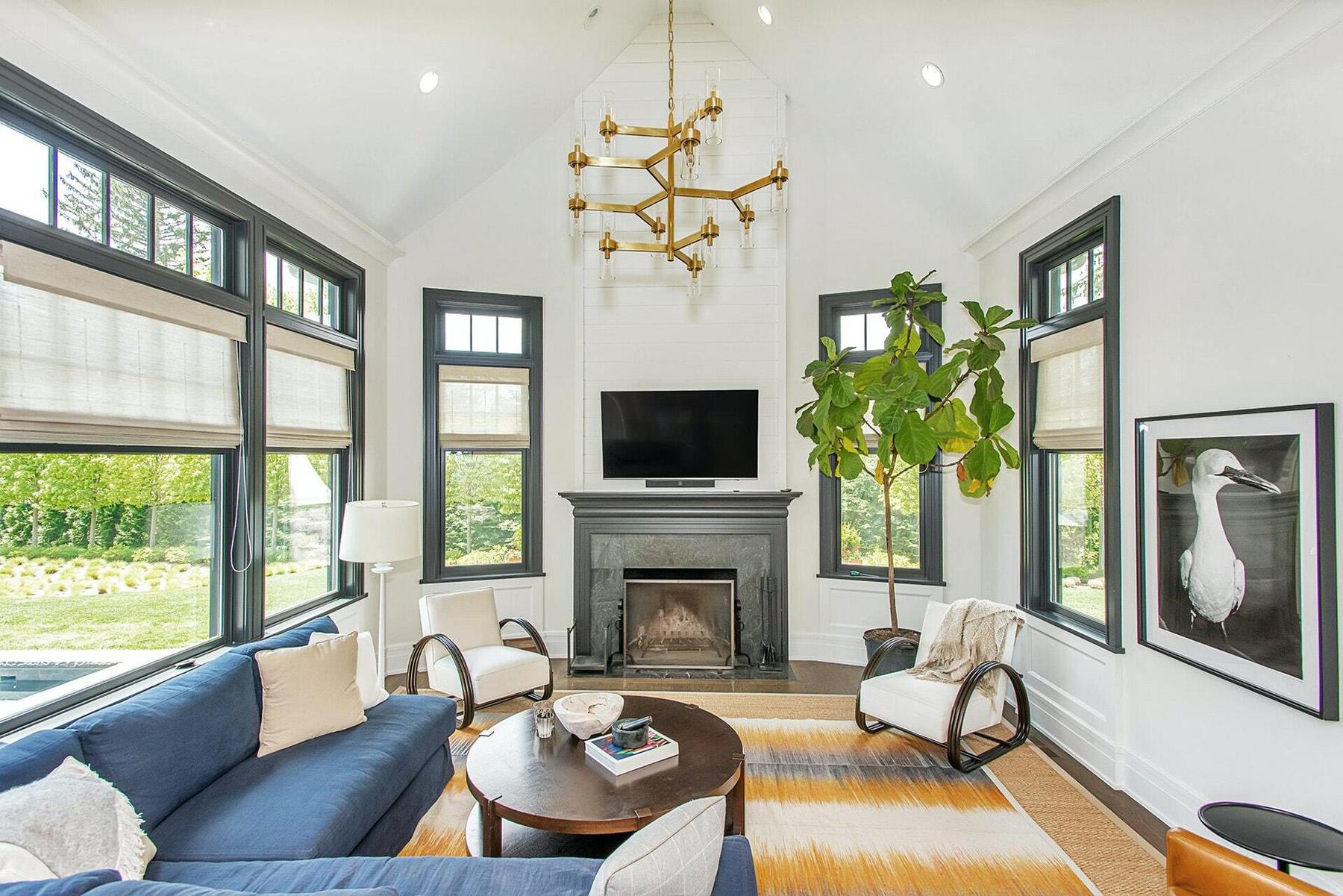Living room with black wood windows.