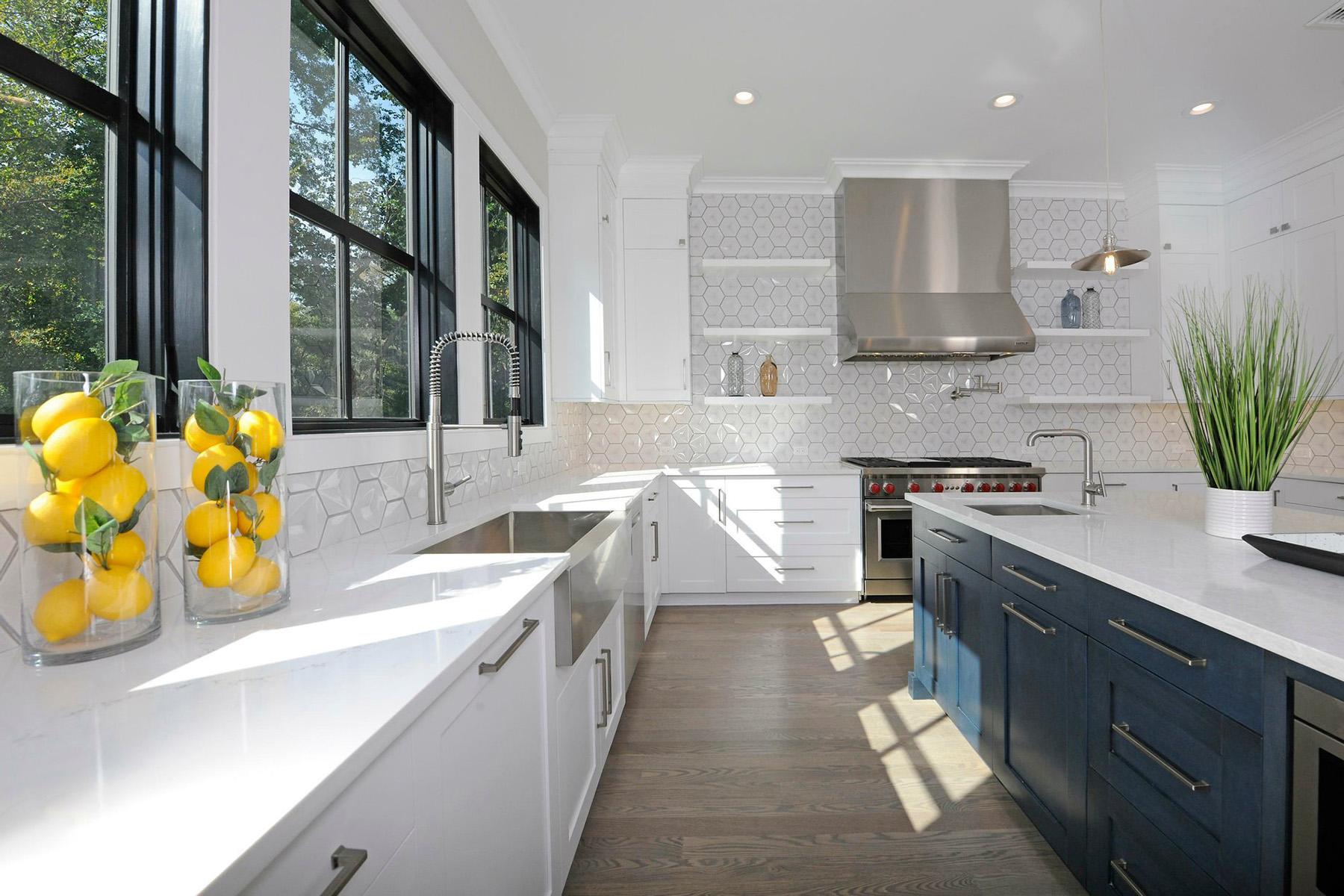 Beautiful kitchen with white countertops & black windows.