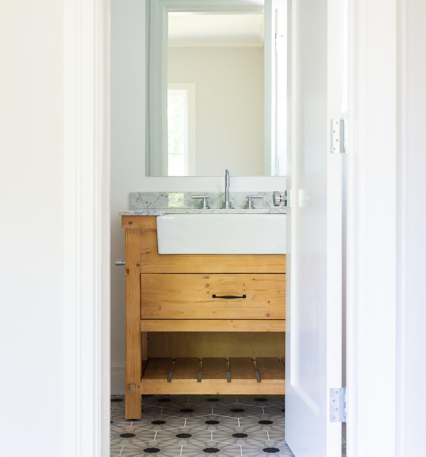 budget bathroom remodel with wood vanity and farmhouse sink