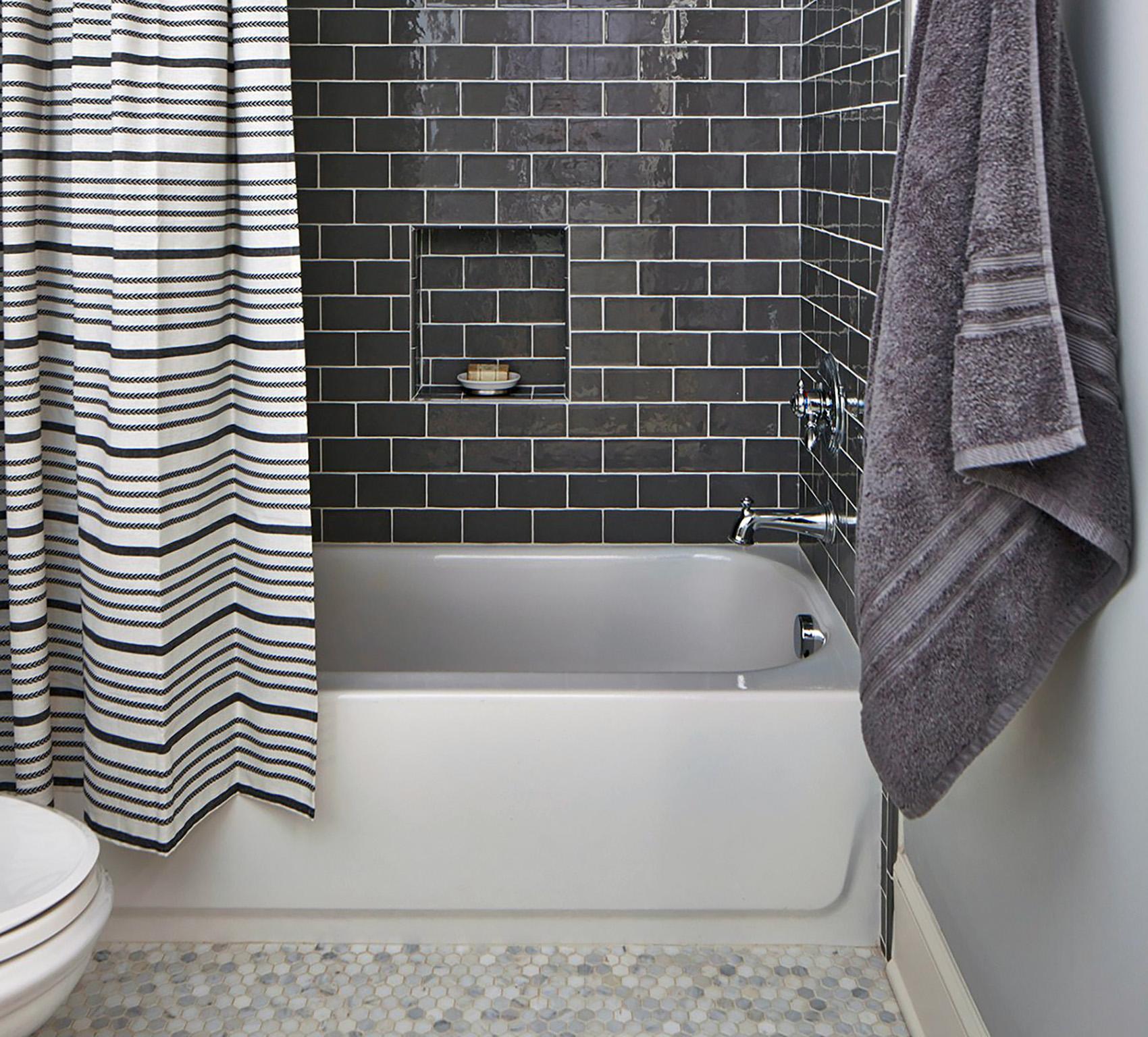 cheap bathroom renovation gray tiles white grout
